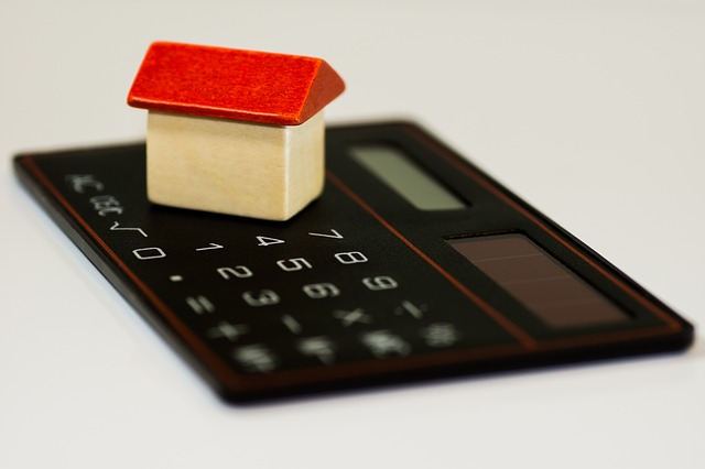 Image of calculator and house