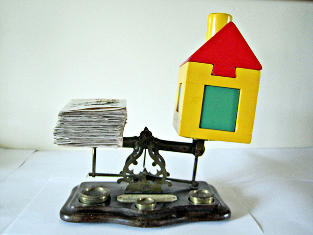 Image of House and Money on Scales